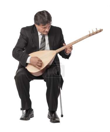 Mature musician man playing reed