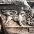 Griffin relief at the Temple of Apollo in antique ...