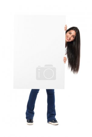 Smiling girl holding a blank board