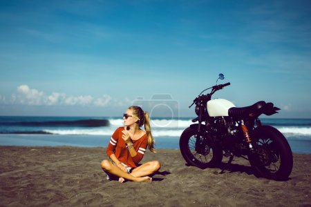 girl and vintage custom motorcycle