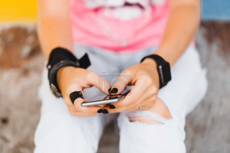 Fitness girl  listening to phone
