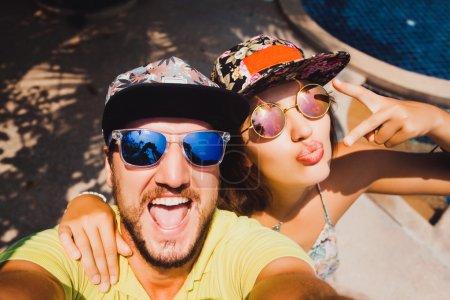 couple in caps  making the selfi