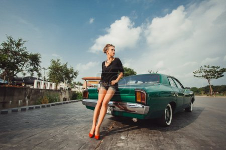 girl   posing near vintage car