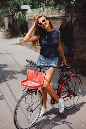 Girl with  red retro bicycle