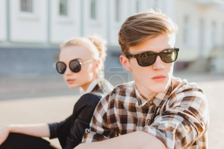 fashionable couple in sunglasses
