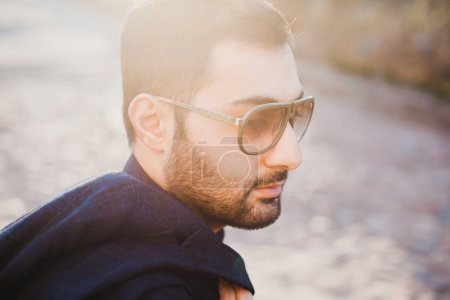 young man with beard and sunglasses