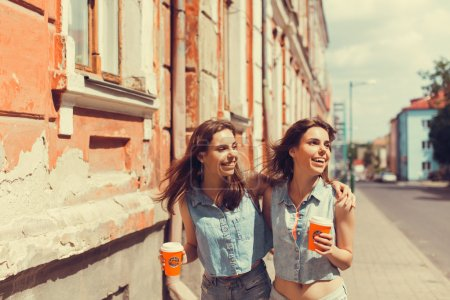 brunette girlfriends drinking coffee