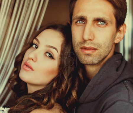 Young beautiful couple posing