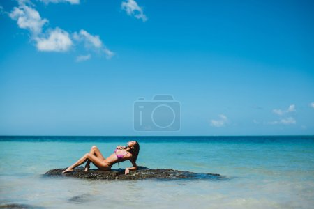 beautiful woman posing in the beach