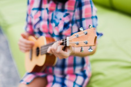 Photo for Portrait of  young woman playing ukulele - Royalty Free Image