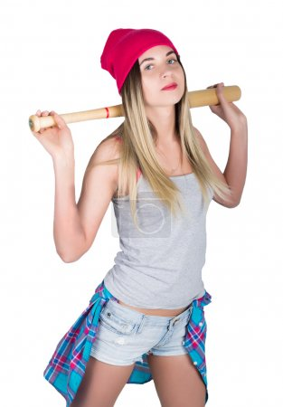 teenager girl in denim shorts and a gray T-shirt and a pink knit hat, tied at the hips plaid shirt.  holding a baseball bat. isolated on white background