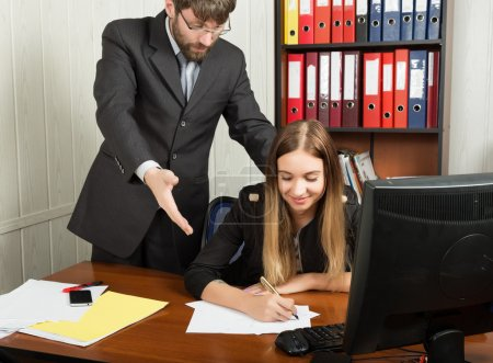 relations between superiors and subordinates. Angry boss screaming to his employer woman and she is surprised and shocked