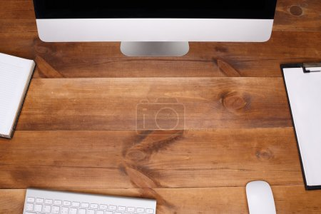 top view of wooden workplace.