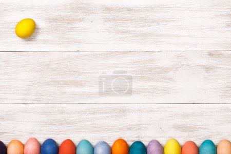 Wooden workplace with colorful eggs