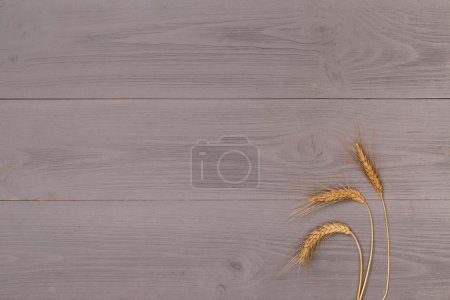 Wheat ear on  wooden table