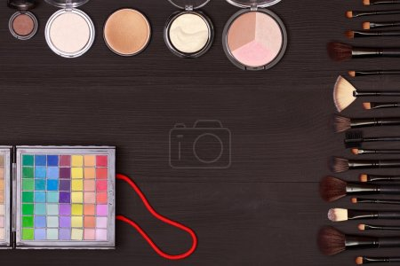 Set of cosmetics on wooden table