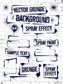 Various Spray paint graffiti on brick wall Frame with black ink blots Spray grunge background
