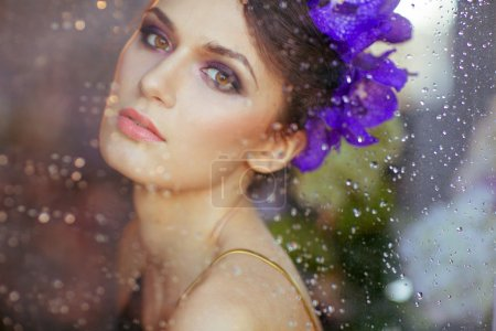 Very sensual beautiful brunette woman with flowers in her hair b
