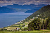 Beautiful views from mountain to fjord, the mountains and the sm