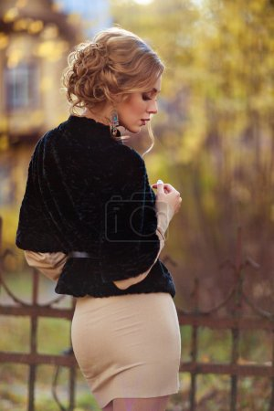 Photo for Portrait in profile of a sensual kinky girl in black coat autumn - Royalty Free Image