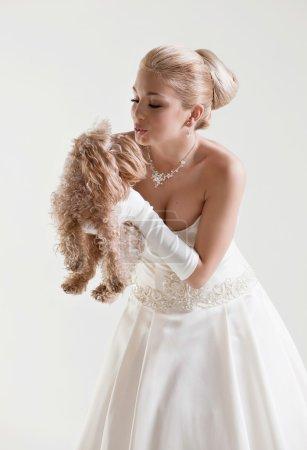 Portrait of beautiful delicate blonde bride in a wedding dress k