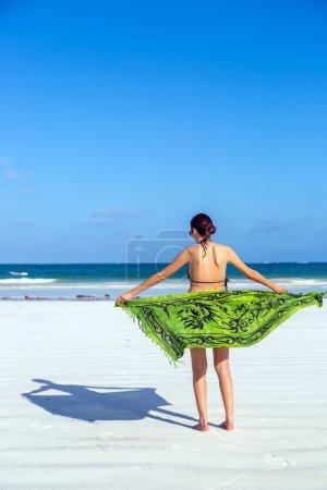 lady enjoying beautiful beach