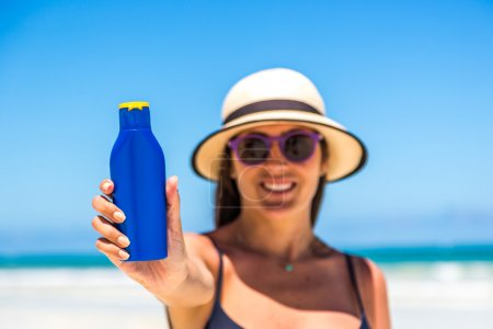 woman using sunblock cream