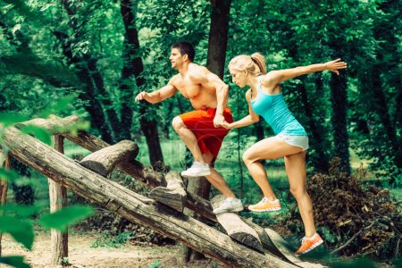 Fitness trail couple crossing obstacle