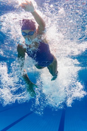 Front crawl swimmer underwater