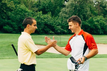 Two young golfers closing the game