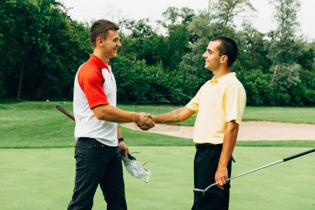 Friends shaking hands after golf