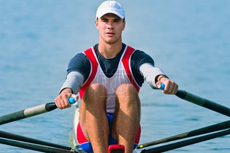 Single scull rowing competitor