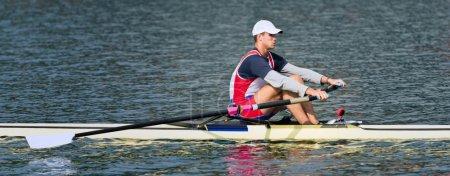 sportsman rowing single scull