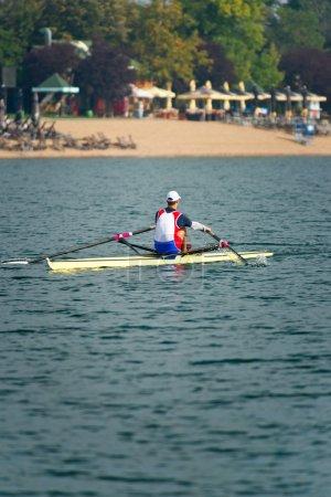 athlete rowing on lake