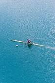 Single scull on lake