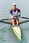 Single scull rowing athlete