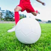 Soccer player kicking ball