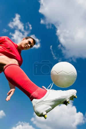 Soccer player controlling the ball