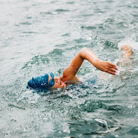female athlete swimming long distance