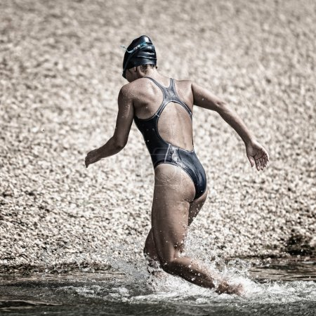 Triathlete coming out of water