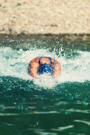 Triathlon athlete swimming