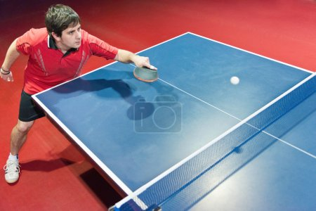 Table tennis player in action