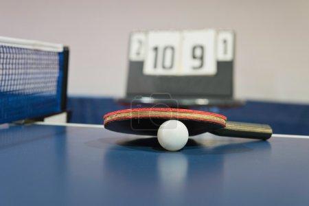 Table tennis racket and ping pong ball