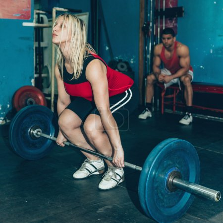Blond Female lifting weights