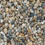 Beach grey pebble stones texture...