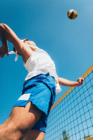 Beach volleyball Player on Net