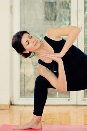 Woman in twist prayer position