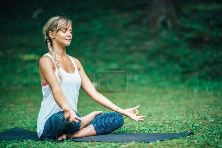 relaxed woman doing Yoga