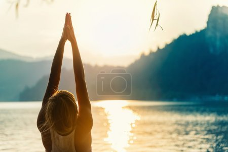 woman practicing Sun salutation