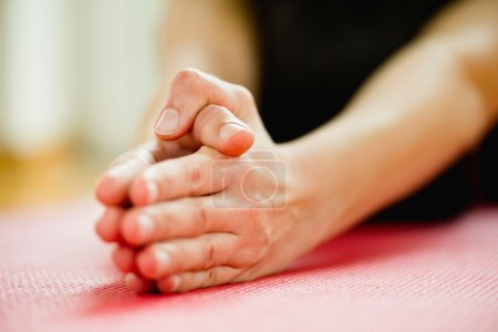 Hands practicing Yoga